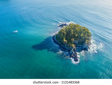Aerial views of Snapper Island sitting 1 kilometre offshore in pristine aqua green waters of Batemans Bay Australia.