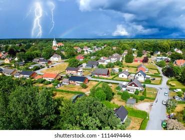 Aerial village view in stormy season