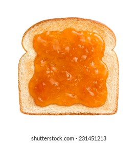 Aerial vtew of Apricot Preserves on a single slice of lightly toasted white bread. Isolated on white.