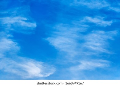Aerial white clouds against blue sky background texture