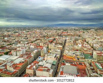 Aerial Wide Shot of Historic Old City on a Cloudy/ Stormy Afternoon [Summer] - Mexico City, Mexico (La Ciudad de Mexico)