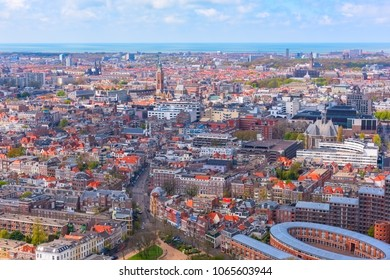Aerial wide-angle cityscape of The Hague (Den Haag) with the North Sea and cloudy blue sky, Netherlands