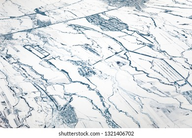 aerial winter view to Usbekistan agriculture landscape in snow