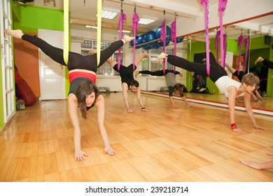 Aerial yoga practicing - anti gravity yoga with scarves
