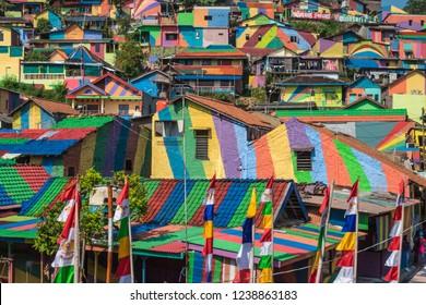 Aerial/bird eye view of colorful houses in Kalisari Rainbow Village (Kampung Pelangi Kalisari) in Semarang, Central Java, Indonesia.