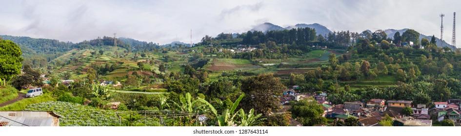 Aerial/bird eye view of a rural Indonesian village in Puncak, Ciloto, Cianjur, West Java, Indonesia.