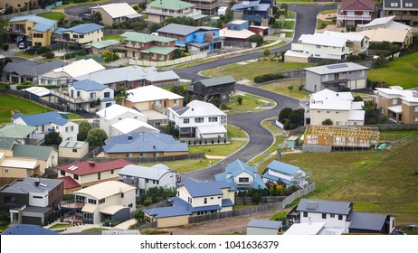 Aerial/elevated view of residential houses and suburban street in a typical Australian rural town. Apollo Bay, VIC Australia.