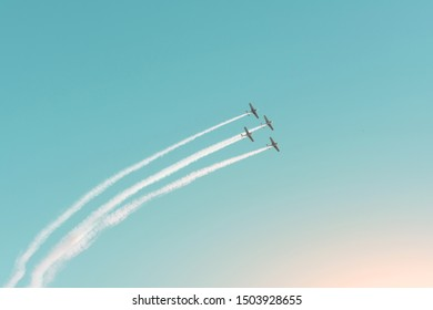Aerobatic team fly smoothly on turboprop light-engine aircraft in the air
