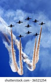 Aerobatics team flying in formation.