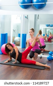 Aerobic Pilates personal trainer instructor in women gym fitness class