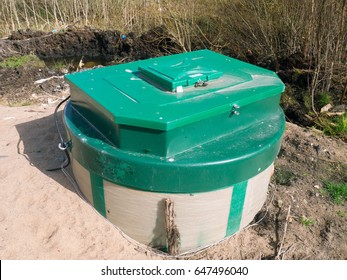 Aerobic waste water treatment system (ATS). Green top septic tank.
