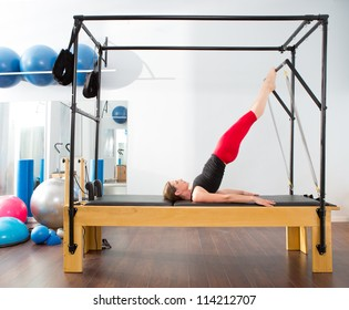 Aerobics pilates instructor woman in cadillac fitness exercise