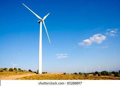 aerogenerator windmill blue sky and golden field