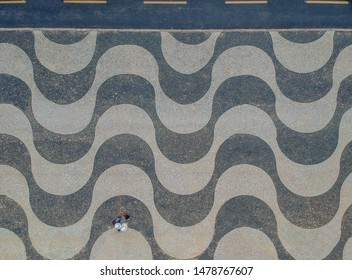Aerophotography of Copacabana beach .Top View of Copacabana beach with mosaic of sidewalk in Rio de Janeiro. Brazil  - is a favorite place for tourists from all over the world.