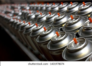Aerosol cans on production line in factory
