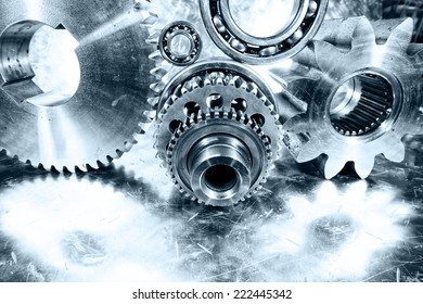 aerospace cogwheels, gears and ball-bearings, mirrored in brushed aluminum