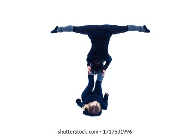 Aeroyogi figures on an isolated white background, performed by a beautiful pair of young gymnasts, twine poses in the air using partner support and body balance