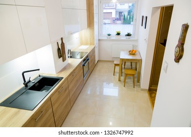 Aesthetic modern narrow kitchen with wooden furnitures