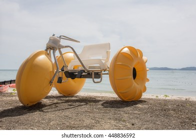 AF focused of yellow water tricycle on the beach with Andaman sea with blue sky background,Phuket,Thailand