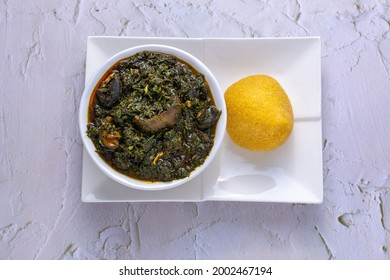 Afang soup served with garri from top view