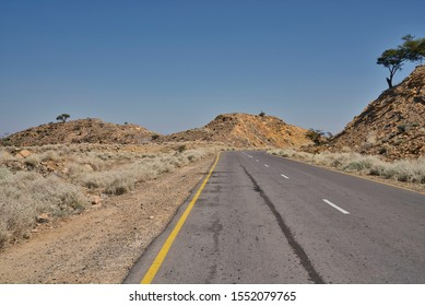 Afar Region, Ethiopia - January 01, 2019: Empty road in the desert in Afar Region, Ethiopia.