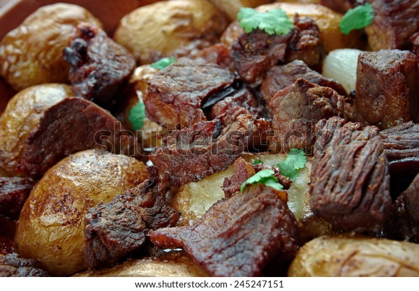Afelia - a traditional Greek and  Cypriot food. pork marinated and cooked in red wine