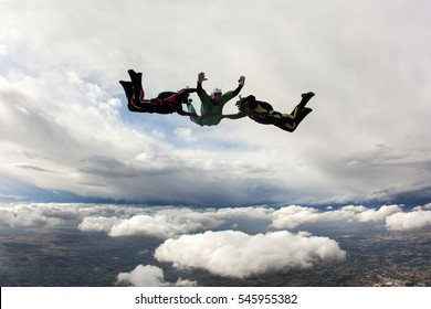 Aff course with Student and jump master with cloudy background