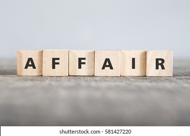 AFFAIR word made with building blocks