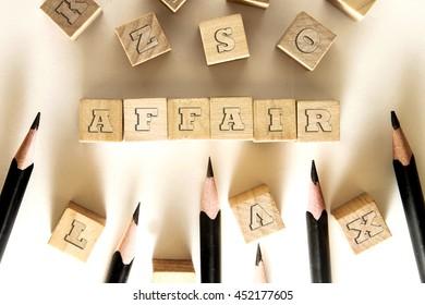 AFFAIR word written on building block concept