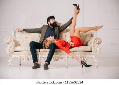 affair at work. love affair of bearded man and sexy woman. sweet affair concept. couple in love has an a affair