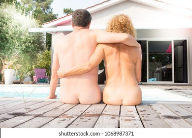 Affectionate couple lovers embrace nude nudist concept