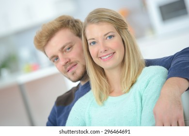 Affectionate couple sitting on a sofa