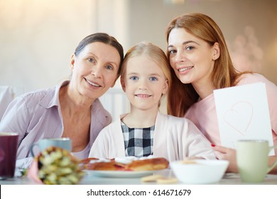 Affectionate family looking at camera on mother day