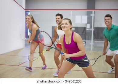 Affectionate friends during the squash game
