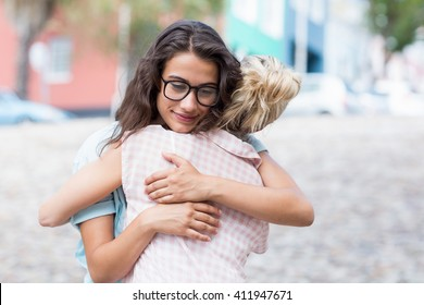 Affectionate friends embracing each other