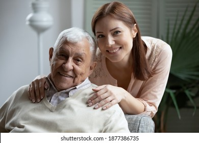 Affectionate grownup daughter embrace retired elderly dad sharing optimism positive emotions. Tender young woman hug beloved old grandfather dreaming together of good happy future long healthy life