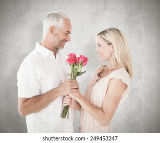 Affectionate man offering his partner roses against weathered surface