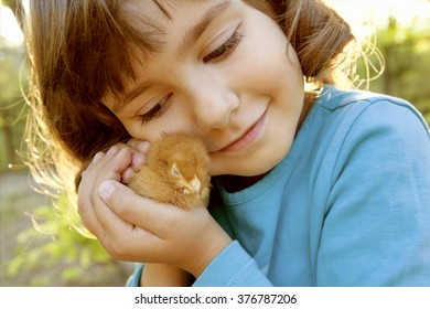 Affectionate Tender Girl Holding Chicken in Hands Like a Treasure