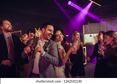 Affectionate young couple dancing together in a nightclub