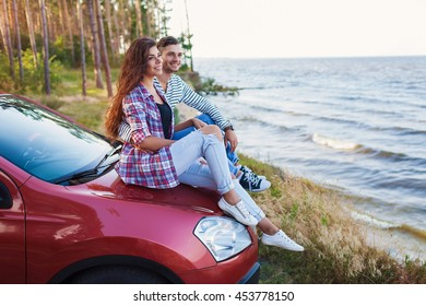 affectionate young couple on a road trip