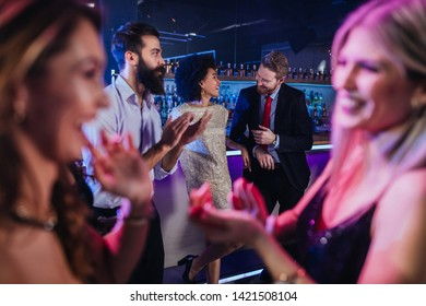 An affectionate young couple partying in a nightclub