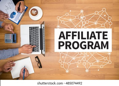 AFFILIATE PROGRAM Business team hands at work with financial reports and a laptop