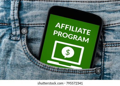 Affiliate program concept on smartphone screen in jeans pocket. All screen content is designed by me. Flat lay