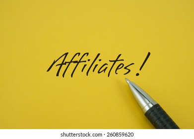Affiliates! note with pen on yellow background