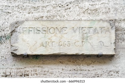 Affissione Vietata sign on the wall in Rome, Italy