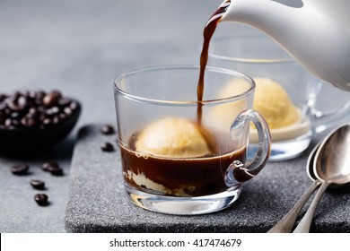 Affogato coffee with ice cream on a glass cup Grey slate background