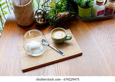 Affogato coffee with ice-cream on wooden plate