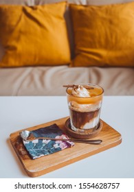 Affogato coffee: One shot hot espresso Topped on vanilla ice cream decorated with whipped cream and caramel sprinkled with powder and decorated with cinnamon