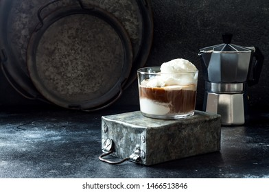Affogato coffee with vanilla ice cream. Summer coffee drink with ice cream and espresso in the glass