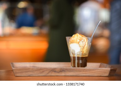 "Affogato, Italian coffee-based dessert with vanilla ice cream topped or ""drowned"" with a shot of hot espresso. Some variations also include a shot of amaretto, Bicerin, or other liqueur."